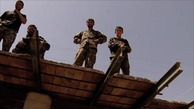 Afghan National Army troops on a rooftop