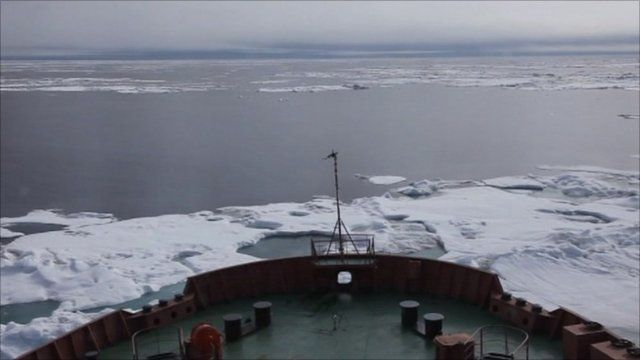 Prow of boat in water and ice