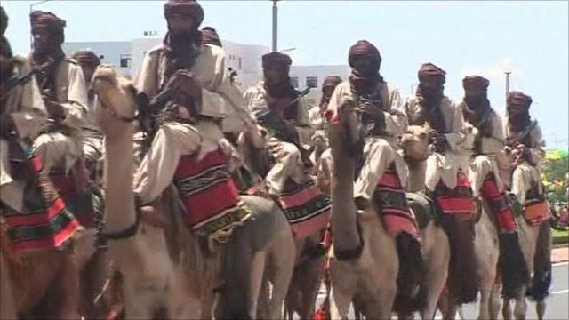 Men riding camels to mark 50 years of Mali's independence