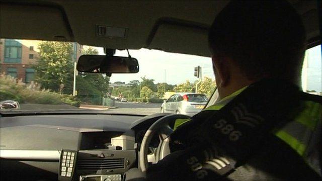 Policeman in car