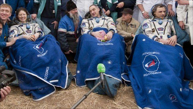 U.S. Astronaut Dyson and, Russian cosmonauts Skvortsov and Kornienko