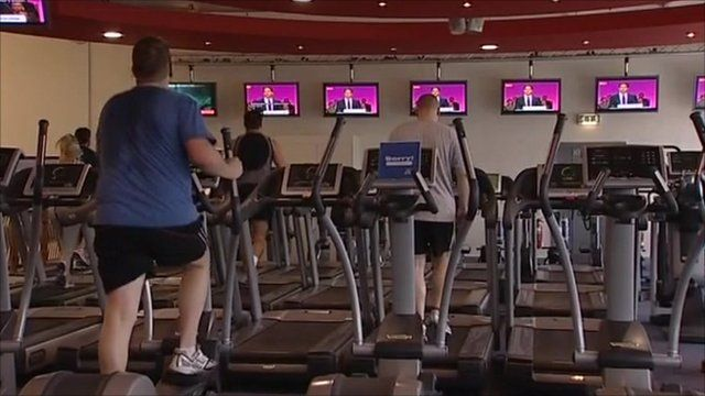 People in gym watching Ed Miliband speech