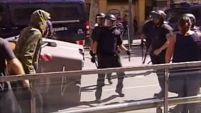 Clashes break out in Barcelona as a general strike gets under way in Spain