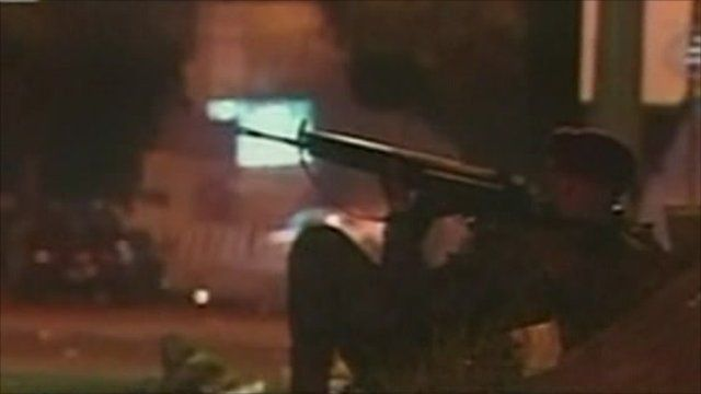 Soldier taking aim