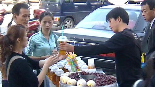 Street vendor and customers