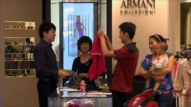 Shoppers in an Armarni shop