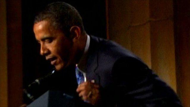 Barack Obama studies his lectern