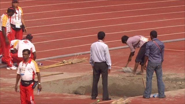 Workmen on athletics track