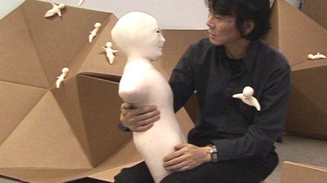 Hiroshi Ishiguro with the Telenoid R1
