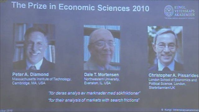 Pictures of the Nobel winners on an overhead screen