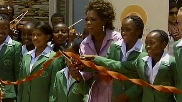 Oprah cuts ribbon with school children