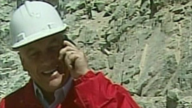 The Chilean President Sebastian Pinera takes a call from David Cameron