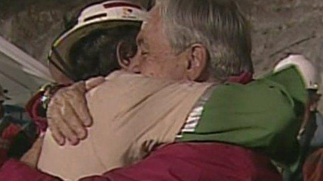 Juan Aguilar embraces Sebastian Pinera