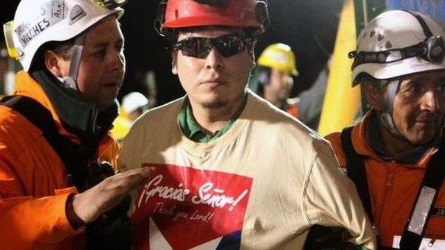 Pedro Cortez (centre) with rescue workers