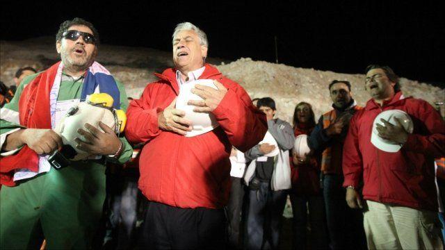 Chile's president Sebastian Pinera stands with chief supervisor Luis Urzua