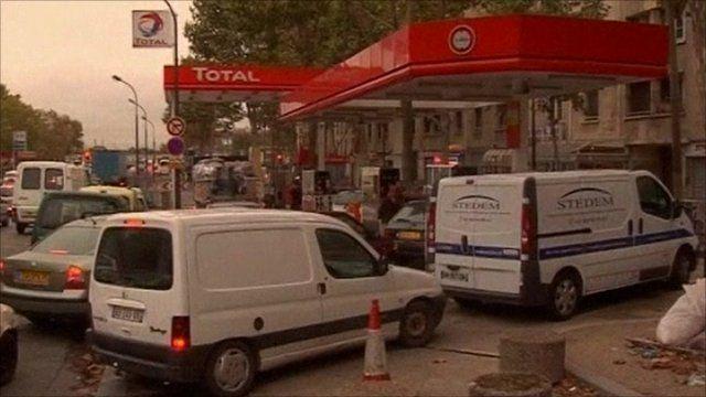 Vehicles queue at petrol station
