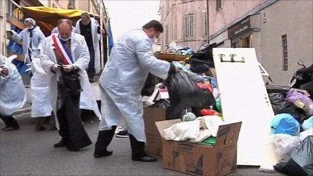 Council workers in Marseille clearing rubbish from streets