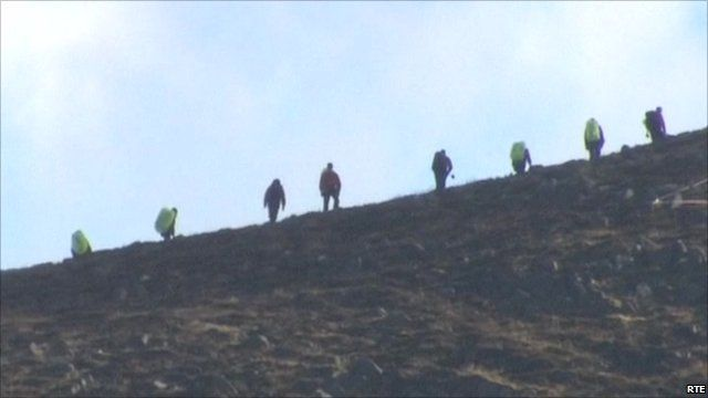 Recovery workers combing the mountains