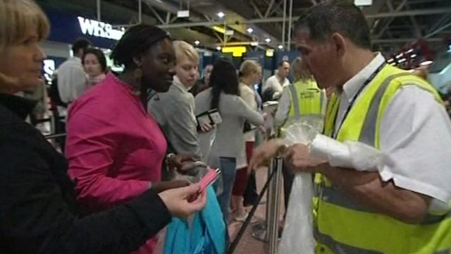 People putting liquids in bags at airport