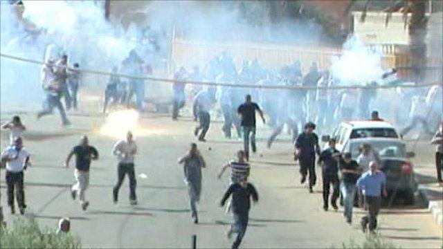 Israeli riot police firing tear gas in Arab town of Umm al Fahm