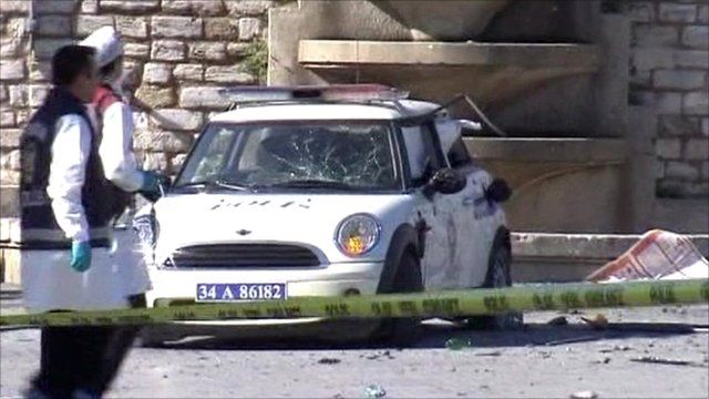 Police car damaged by the explosion in Istanbul