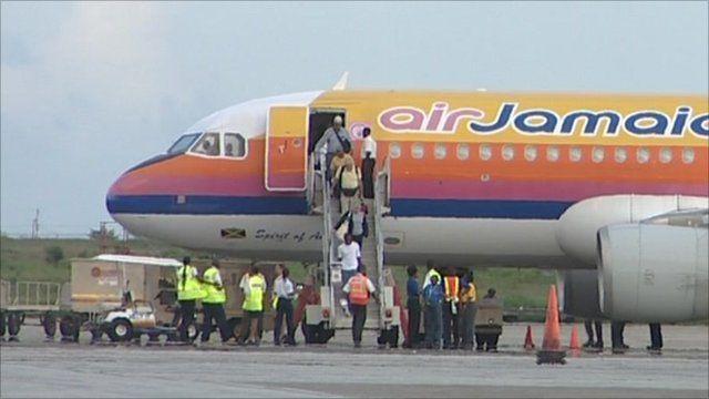 Passengers departing aeroplane