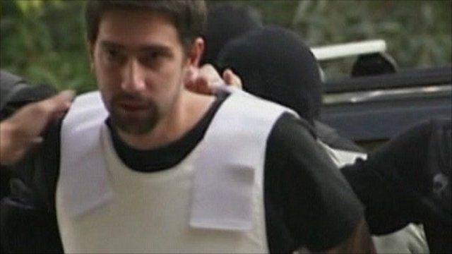 Defendant is brought to court in Greece