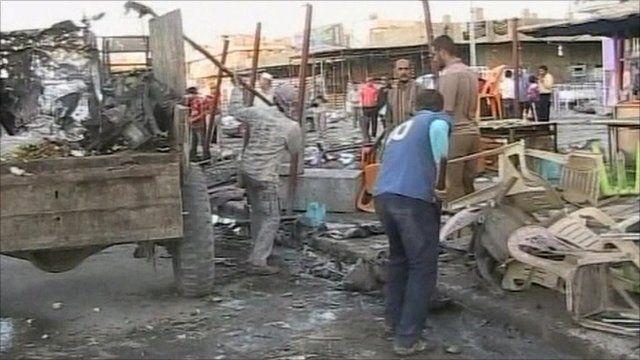 Men loading debris into truck
