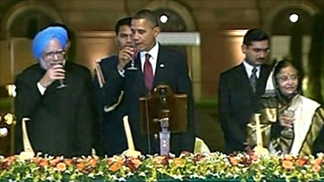 President Barack Obama proposes a toast at a state dinner in India