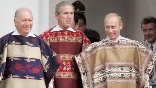 Former US President Bush (middle) and Russian President Vladimir Putin (right), wear Chilean ponchos