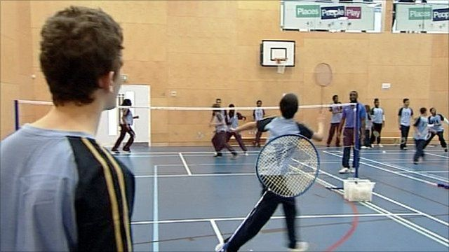 Young people playing badminton