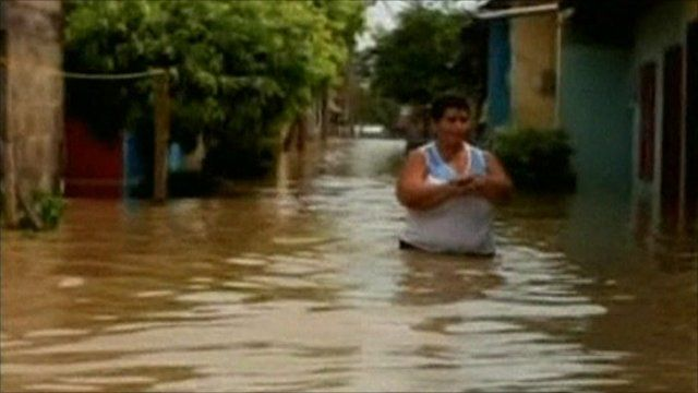 Person wades through water in Colombia