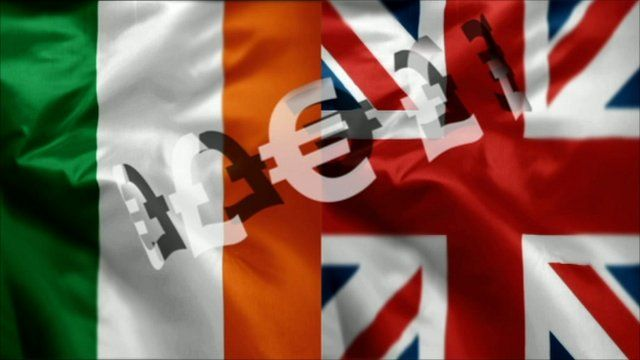 Graphic of Irish and British flags overlaid with sterling and euro signs