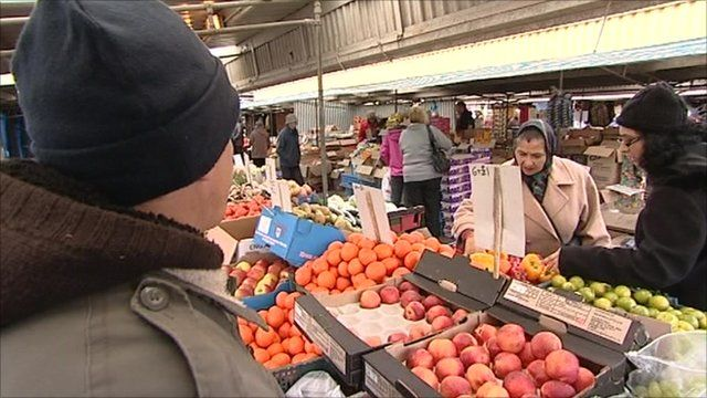 Shoppers check out produce at Bilston market