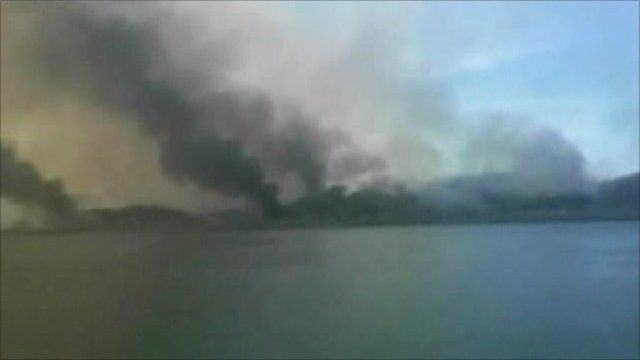 Smoke rises over the island that came under attack