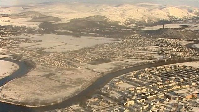 Aerial views of snowbound Scotland