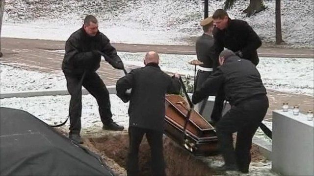 A coffin lowered into the ground