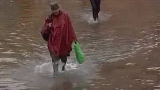 Woman walking in flooded streets