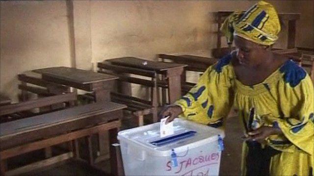 Woman casting ballot