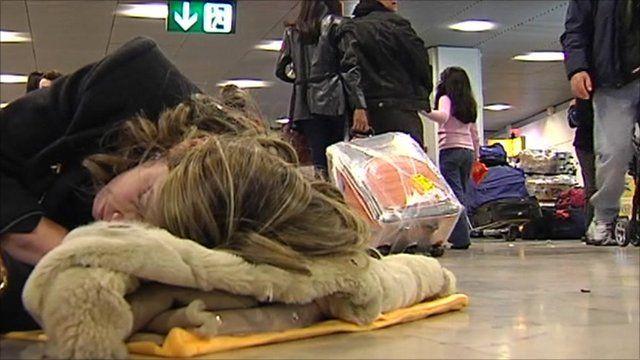 Stranded passenger sleeping on floor