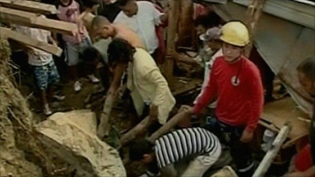 Searching through rubble after mudslide