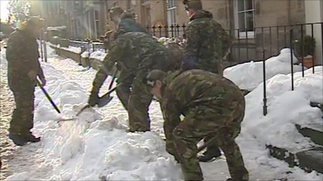 Army officers clearing snow