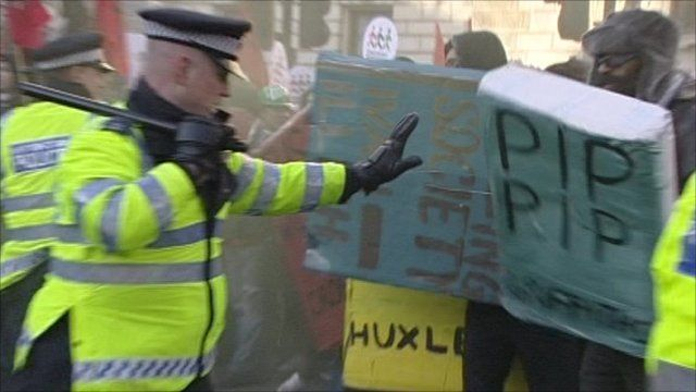 Police officer pushes back protesters