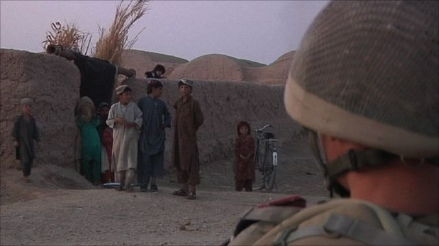 Soldier with Afghan people