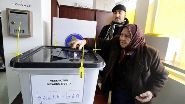 A woman casts her vote at a polling station