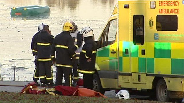 Emergency services at a lake in Lurgan Park
