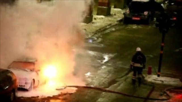 The car bomb flames being extinguished