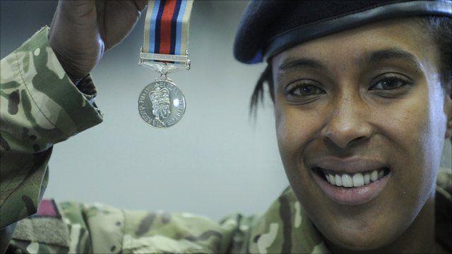 Cheryl Fray receives her medal