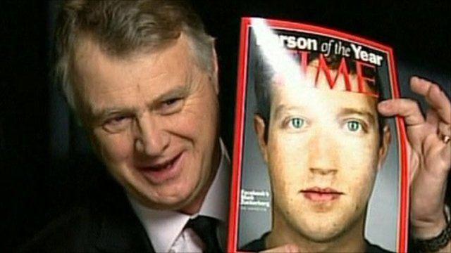 Michael Elliott holds up Time magazine featuring Mark Zuckerberg on cover