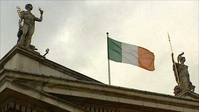 Irish flag between two statues
